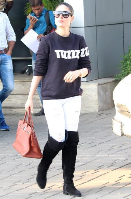 Kareena Kapoor in a black sweatshirt and white ripped jeans  - SeenIt