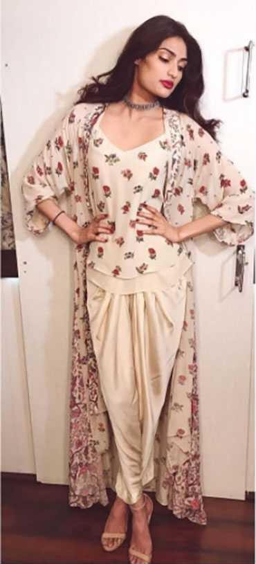Similar white floral top, pants and floral shrug that Athiya Shetty is wearing - SeenIt