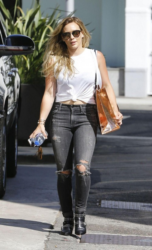 Similar white knotted tee and grey ripped jeans that Hilary Duff is wearing - SeenIt