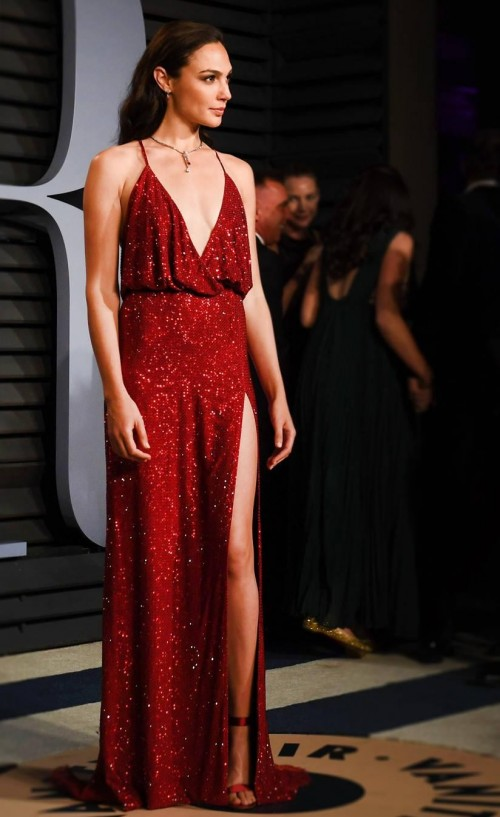 9a2be0f2e3 Gal Gadot in this red shimmer slit gown at Vanity Fair of