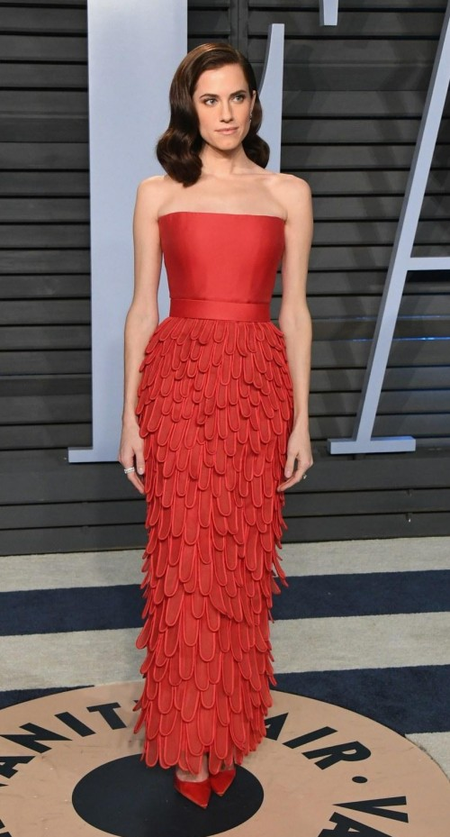 f046701ab6 Allison Williams in this red tube feathers gown at Vanity Fair -