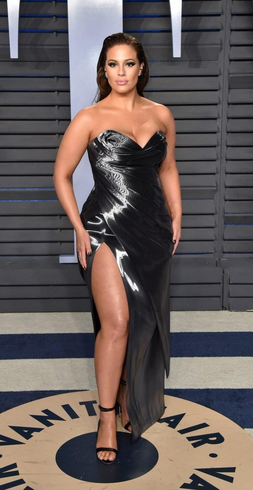 7c1466a67c Ashley Graham in this silver tube slit dress at Vanity Fair -