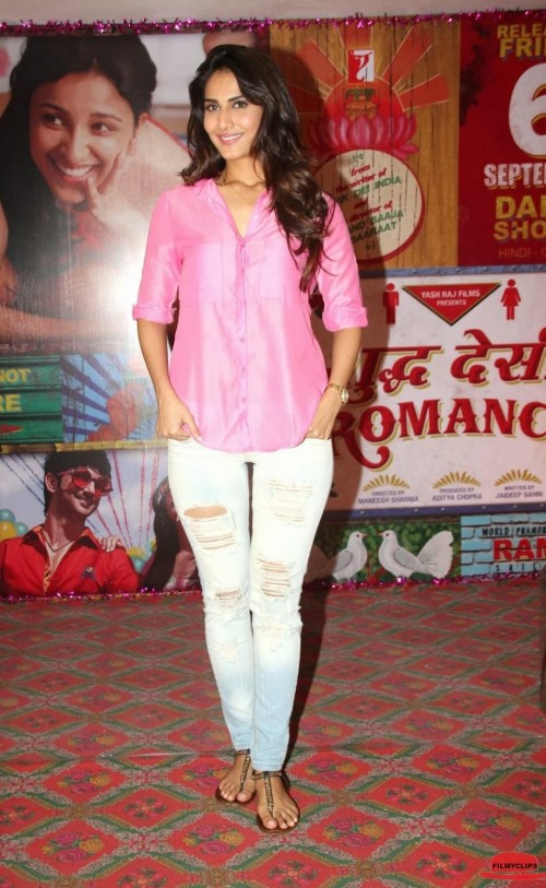 Vaani Kapoor in a pink shirt and blue ripped jeans - SeenIt 15ac0ec9e
