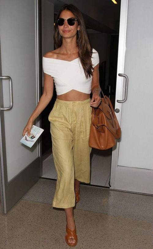 Lily Aldridge in a white off-shoulder croptop and culottes - SeenIt