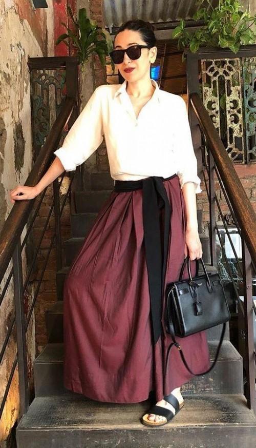 bd54bdbbc5 Similar white shirt and maroon maxiskirt that Karisma Kapoor is wearing -  SeenIt