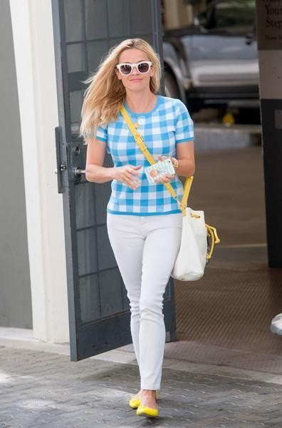 Reese Witherspoon carrying a white bucket bag - SeenIt
