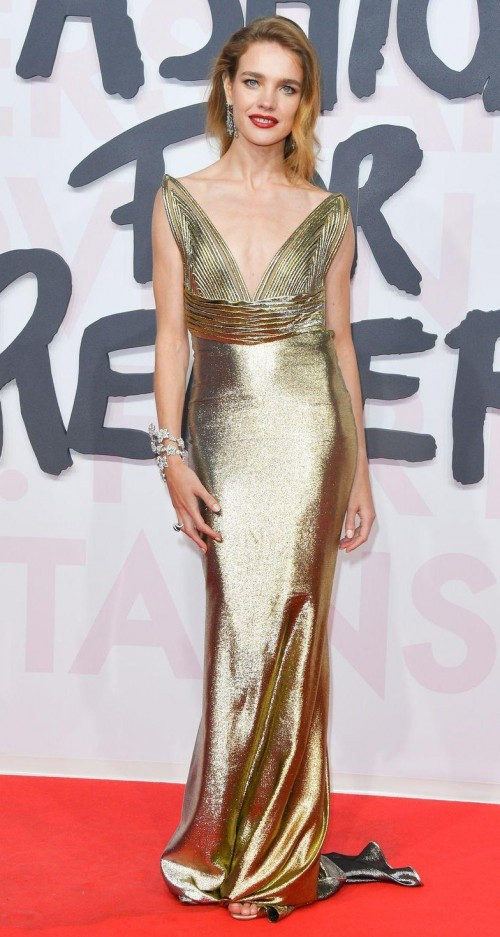 Yay or Nay? Natalia Vodianova nailed the red carpet style in this golden gown. - SeenIt