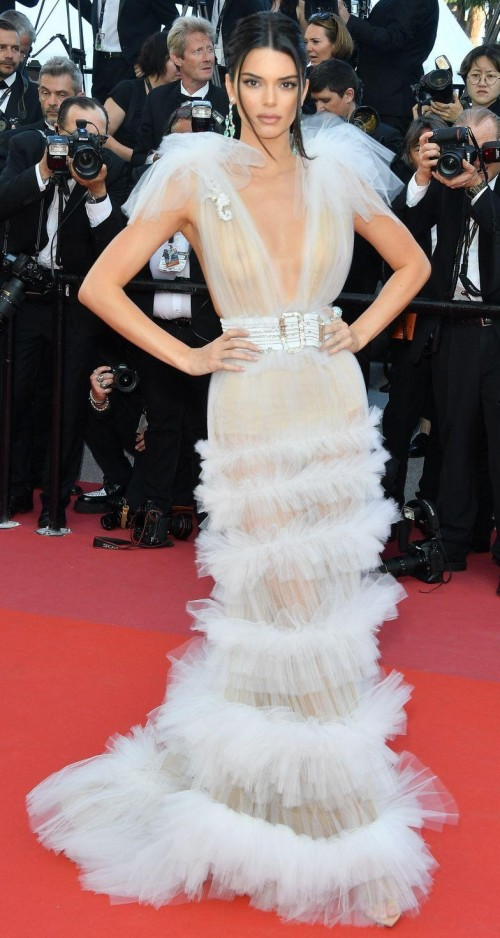 Yay or Nay? Kendall Jenner swept down the red carpet in a white sheer Schiaparelli gown with ruffles skirt at Cannes 2018 - SeenIt