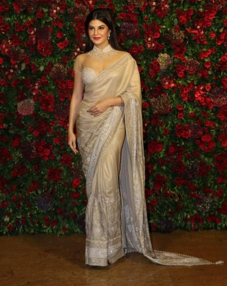 Yay or a Nay? Jacqueline Fernandez wearing a nude colored saree with mesh blouse at the Deepveer reception in Mumbai - SeenIt