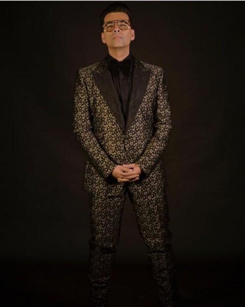 Yay or Nay? Karan Johar wearing a black printed suit at the Deepveer reception in Mumbai - SeenIt