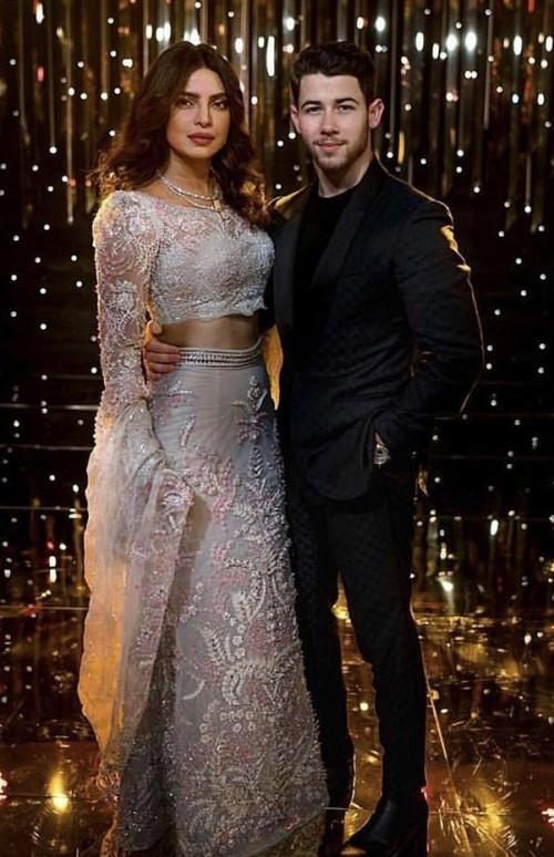 Yay or Nay? Priyanka Chopra and Nick Jonas at their own wedding reception in Mumbai last night - SeenIt