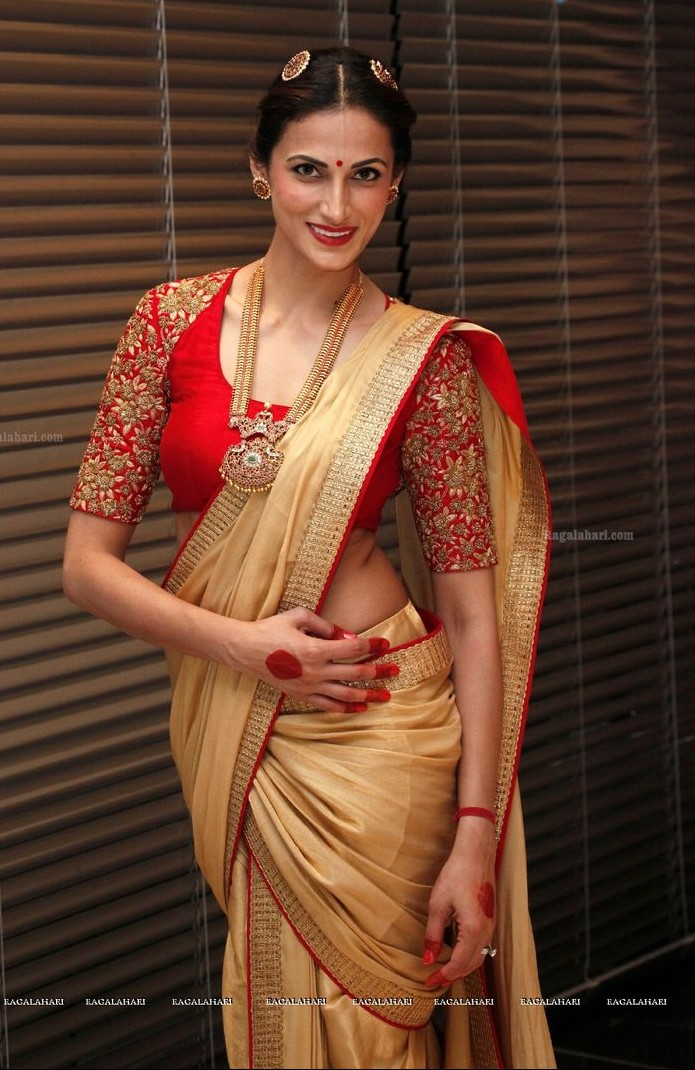 looking for sarees in this red-beige colour combination please. - SeenIt