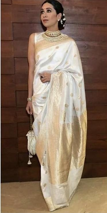 Wana buy same ivory and gold saree which Karisma Kapoor is wearing - SeenIt
