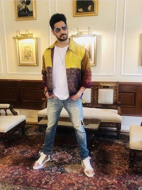 Yay or Nay? Siddharth Malhotra wearing a custom made Ikat story jacket at the promotions of Jabariyajodi - SeenIt