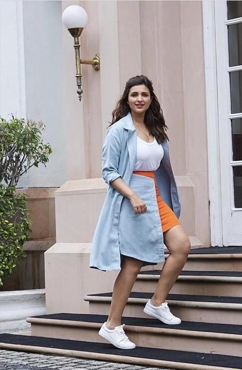 Help me find similar a light blue coat and white sneakers like Parineeti Chopra is wearing - SeenIt