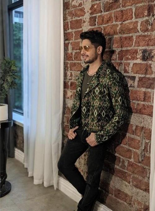 Yay or Nay? Siddharth Malhotra wearing an Ikat story jacket at the promotions of Jabariyajodi - SeenIt