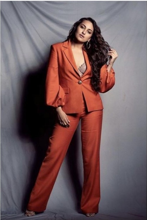 Help me find a similar orange pant suit online like Sonakshi Sinha is wearing - SeenIt