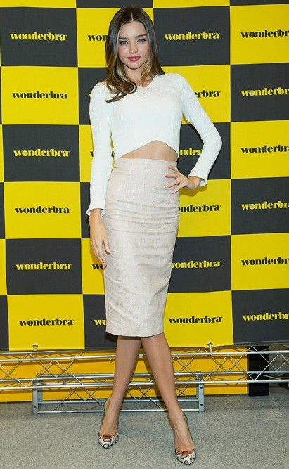 Want to replicate this look of hers ! the white fitted crop top , and silver high waist midi skirt - SeenIt