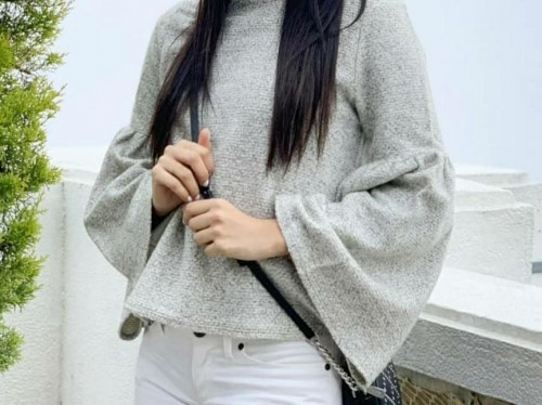 Please find me this grey top with long flared sleeves. - SeenIt