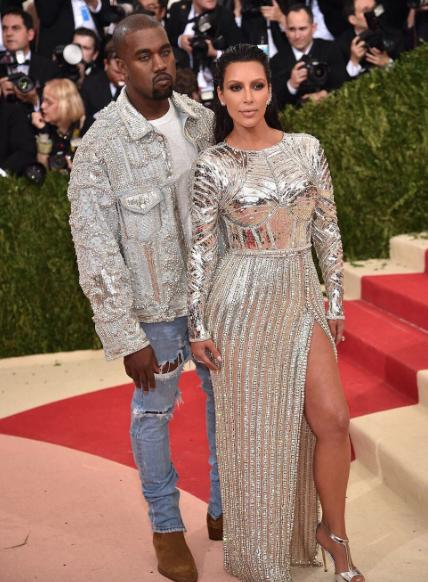Kim and Kanye West took the theme seriously wearing Balmain. - SeenIt