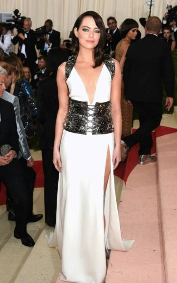 Emma Stone makes her stunning debut at the Met ball wearing Prada with a gunmetal leather harne - SeenIt
