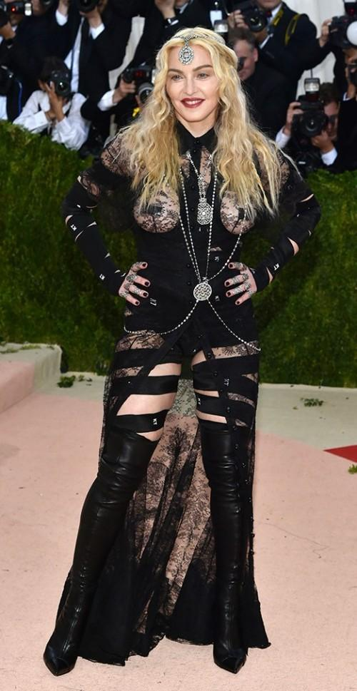 Madonna in a sheer black Givenchy gown. - SeenIt