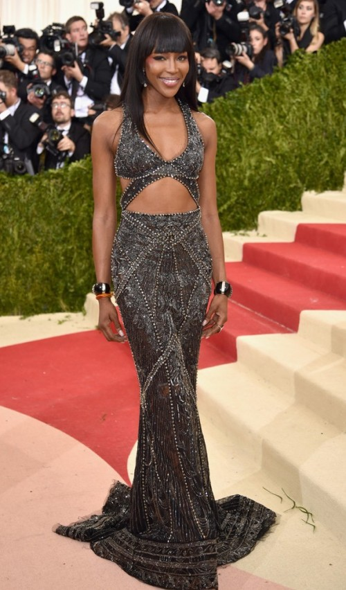 Runway veteran Naomi Campbell  in a beaded metallic gown by Robetro Cavalli.  - SeenIt
