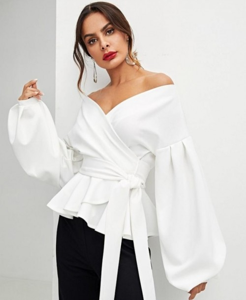 I'm looking for a similar top and earrings too - SeenIt