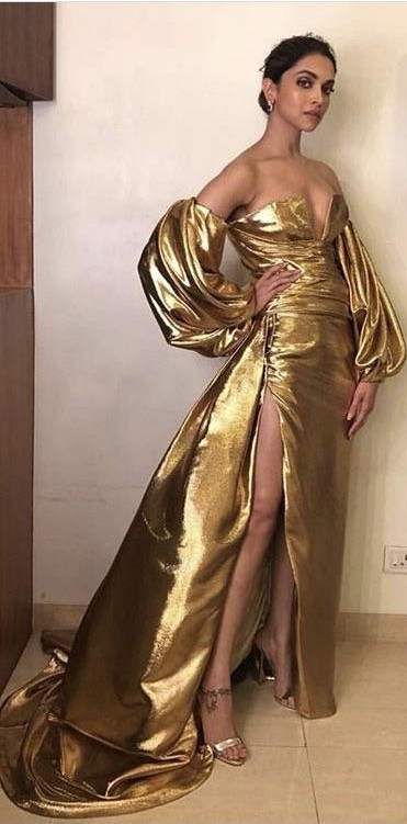 Yay or nay? Deepika Padukone Spotted wearing a  golden metallic gown with a thigh high slit - SeenIt