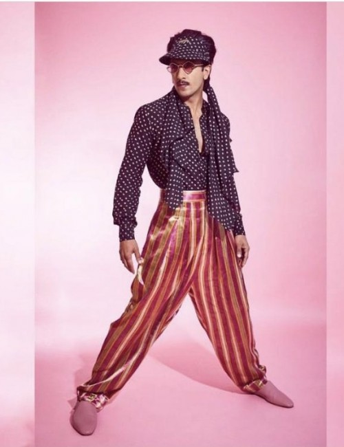 Yay or nay? Ranveer Singh spotted wearing a black polka dotted shirt and metallic shiny pants attire - SeenIt