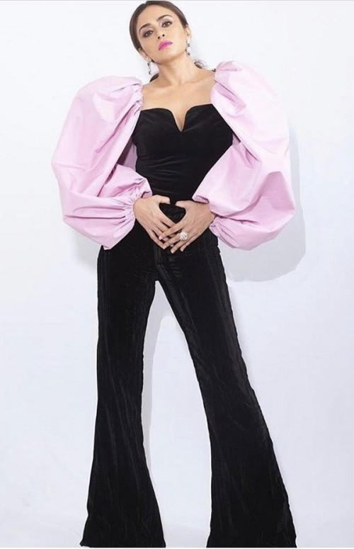 Yay or nay? Amruta Khanvilkar wearing a black jumpsuit with pink puff sleeves - SeenIt