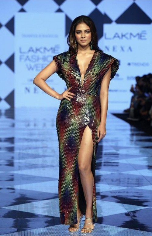 Yay or nay? Malavika Mohana wearing a plunge neckline slit gown at the ramp - SeenIt