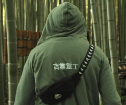 Want green long sleeved hoodie with Asian white writings on the back There are also straps on each sides of the hood. - SeenIt