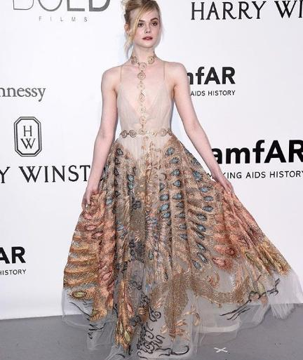 Elle Fanning in wearing Valentino to the amfAR gala. - SeenIt