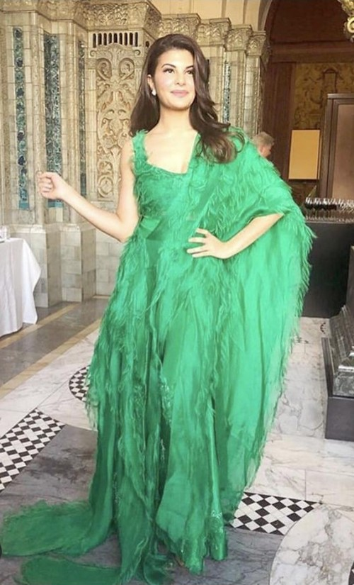 Yay or nay? Jacqueline Fernandez seen wearing a green ruffle and feather style lehenga attire - SeenIt