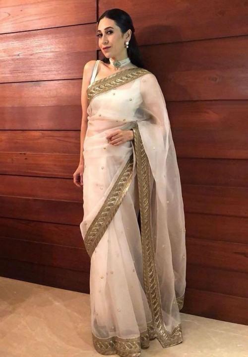 Yay or nay? Karishma Kapoor wearing an ivory and gold saree - SeenIt
