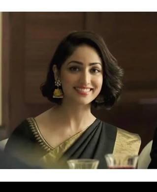 Similar black saree with same earrings - SeenIt