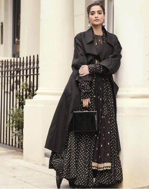 Yay or nay? Sonam Kapoor seen wearing a trench coat over a Sabyasachi anarkali - SeenIt