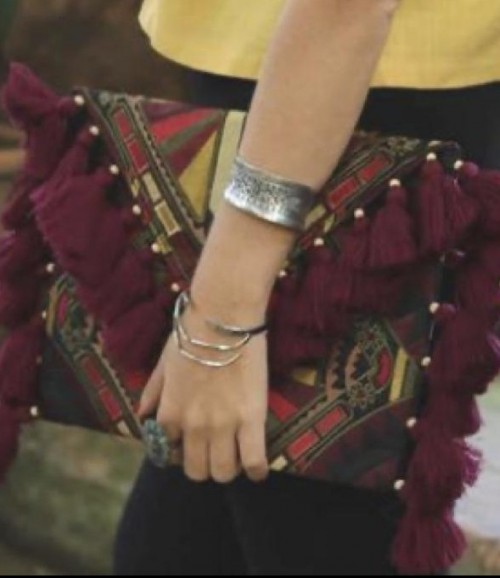 Looking. for this Boho clutch - SeenIt