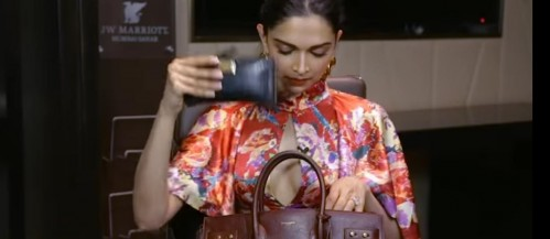 Actually I am looking for a blue colour wallet that Deepika Padukone has shown us on this video . which brand it is . - SeenIt
