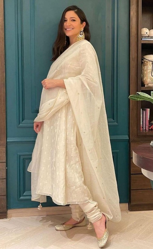 Yay or nay? Anushka Sharma seen wearing an off white embroidered anarkali outfit on diwali this year - SeenIt