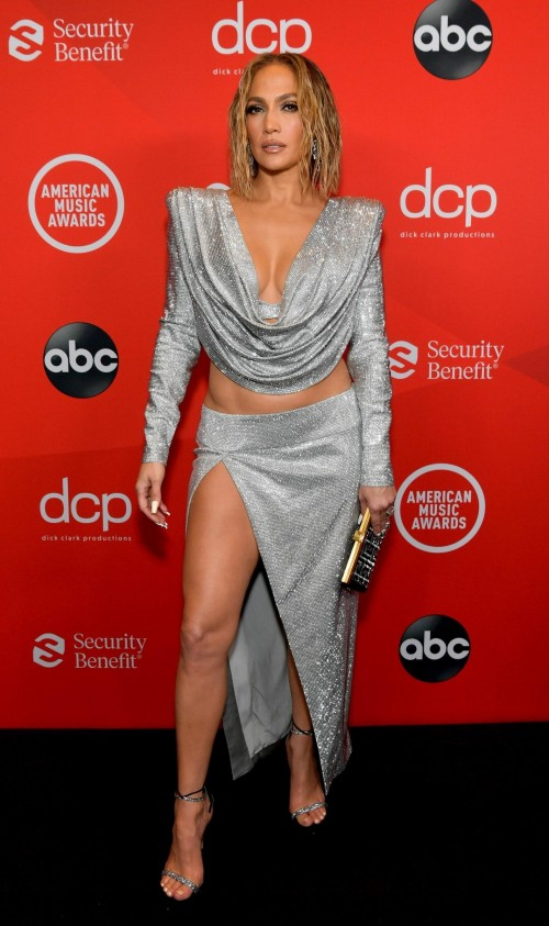 Yay or nay? Jennifer Lopez wearing a silver high slit two piece outfit attends the AMA2020 - SeenIt