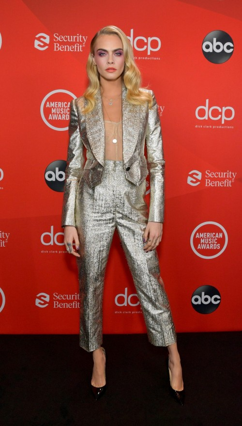 Yay or nay? Cara Delevingne wearing a silver pant suit attends the AMA2020 - SeenIt