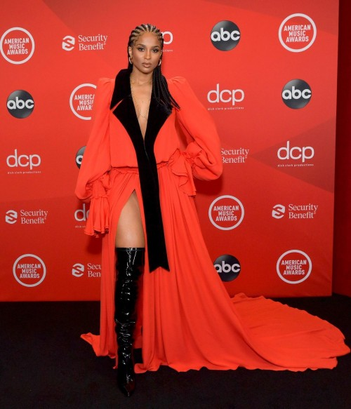 Yay or nay? Ciara wearing a red and black slit gown attends the AMA2020 - SeenIt