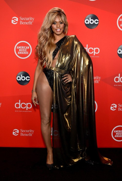 Yay or nay? Laverne Cox wearing a golden metallic mesh gown attends the AMA2020 - SeenIt
