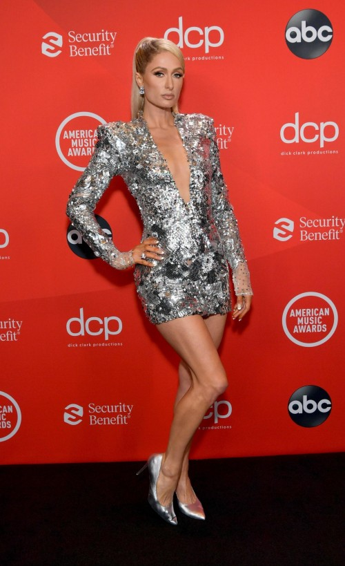 Yay or nay? Paris Hilton wearing a silver plunge neck mini dress attends the AMA2020 - SeenIt