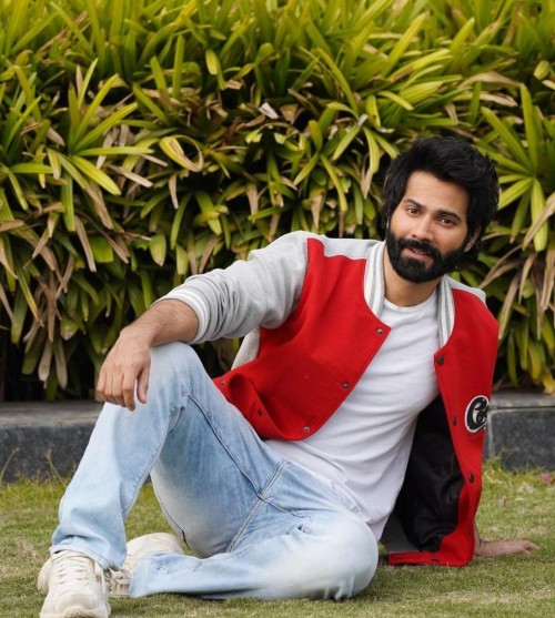 Yay or nay? Varun Dhawan seen wearing a red bomber jacket at the promotions of Coolienumber1 - SeenIt