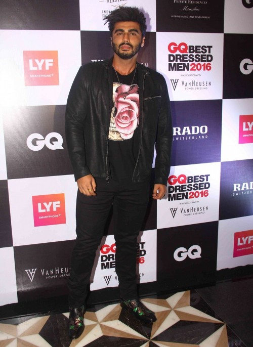 Arjun at the Gq Best Dressed event in Roberto Cavalli boots and John Varvatos bomber jacket. - SeenIt