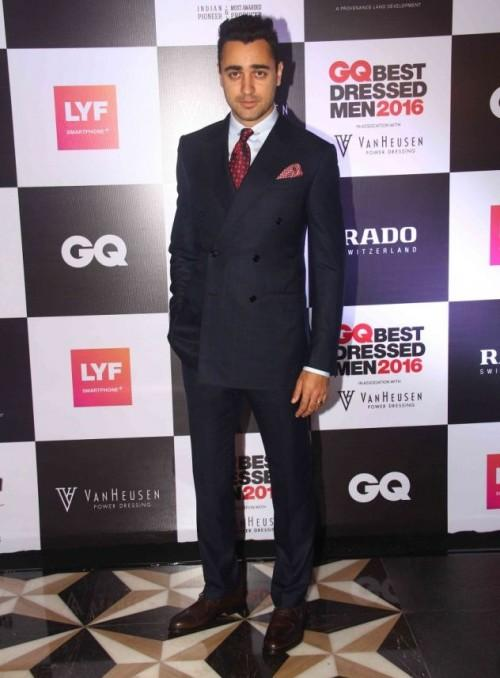 Actor Imran Khan was seen in a classy double-breasted Zegna suit paired with a red tie. - SeenIt