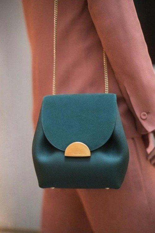 A similar to this teal green sling bag - SeenIt
